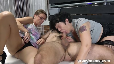 Two of age grannies love to compete in giving blowjobs to a stud