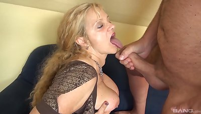 Full-grown amateur granny fucked by a younger dude on the blue sofa