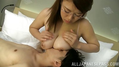 Asian nymph encircling glasses gives a tasty cock an outstanding titjob encircling POV