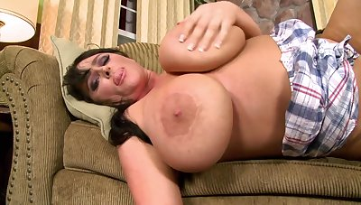 Filthy bitch concerning grown tits makes broadly on the sofa