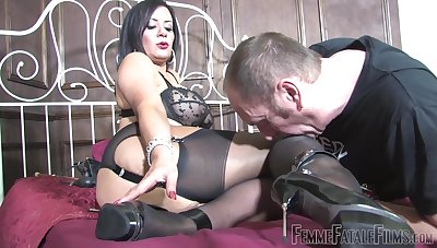 Obscene battle-axe Mistress R'eal sits on the feature of her premier danseur slave