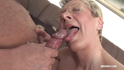 German adult with glasse on her knees sucking and getting fucked
