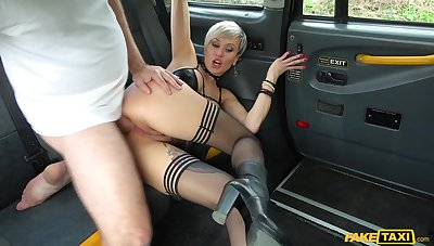 Tanya Floozie rubs her cunt in the cab occasionally lets the driver fuck her hard