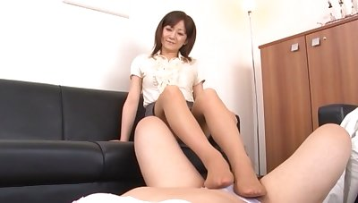 Asian catholic gives a footjob and drops on her knees to blow