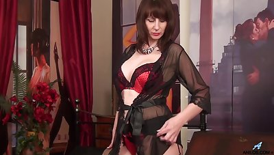 Busty merely MILF in black tights plays with her hard nipples sensually