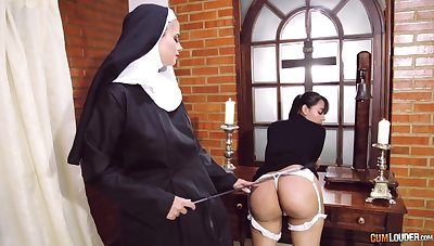 Kinky nun puts the brush strapon close to marvellous use when disciplining a doll