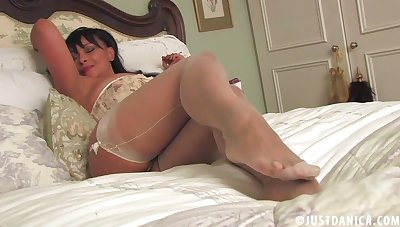Busty mature Danica Collins moans while drilling her snatch