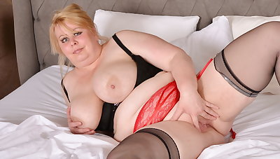 Mature BBW Adriana strips coupled with fingers