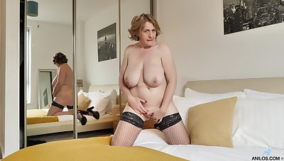 Solo mature Camilla Creampie takes off her peppery panties to play